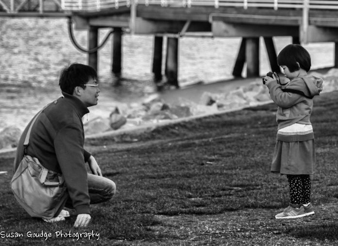 girl taking dad's pic_Snapseed