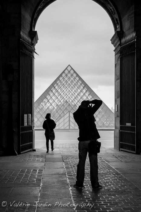 I know that this shot has annoyed a lot of photographers. The arch is incomplete and the Pyramid is not centered. Granted, the famous landmark adds a nice sense of place. I only had a fraction of a second to get behind the photographer and get the movement of the woman walking out to get both silhouettes. Centering the pyramid was the least of my worries because the shot was not about the landmark, it was about the silhouette..