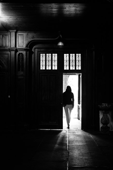 She walked from the darkness into he light wearing black & white ~ Dinan, Brittany. ©Valérie Jardin